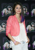 th 63088 SelenaGomezacceptsagoldrecordforheralbumWhenTheSunG 0029 123 249lo Selena Gomez   Receives gold record for When The Sun Goes Down, Four Seasons Hotel, Jan. 26, 2012